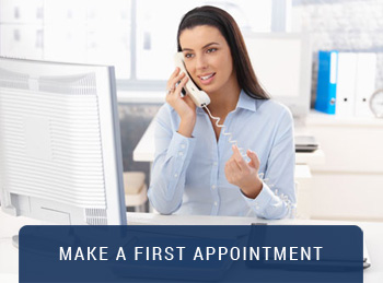 girl on the phone with Make A First Appointment caption