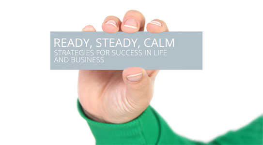 "Hand holding a card with the words ""Ready, Steady, Calm"" written on it"