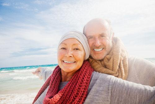 elderly couple at the beach